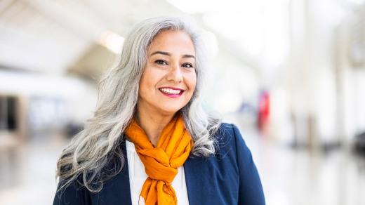 Senior Hispanic Woman Portrait in Airport